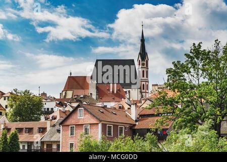 The St. Vitus Church is located in the town of Cesky Krumlov on the Vltava River in Bohemia, Jihocesky kraj, Czech Republic, Europe - Stock Photo