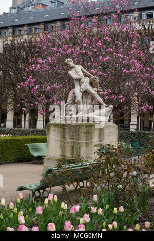 Magnolias behind a marble statue in the Jardin du Palais Royal. Paris, France, Europe - Stock Photo