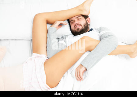 Couple in bed. Insomnia, man can't sleep - Stock Photo