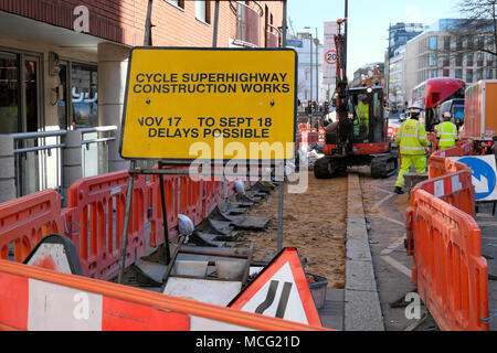 Cycle superhighway construction works sign and workers working on Clerkenwell Road in London UK  KATHY DEWITT - Stock Photo