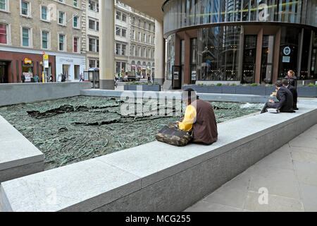 Woman sitting by 'Forgotten Streams' sculpture by artist Cristina Iglesias at the Bloomberg Headquarters building in City of London UK   KATHY DEWITT - Stock Photo