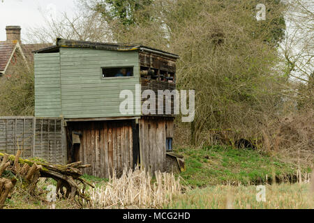 Kingfisher Hide with wildlife photographer's lenses in Rye Meads RSPB nature reserve, Hoddesdon, England - Stock Photo
