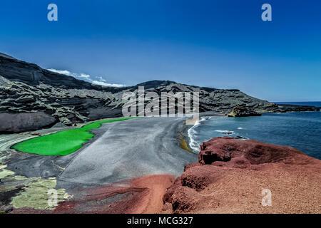 Lanzarote - Crater and lagoon El Golfo - Stock Photo