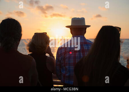 Tourists watching the sunset at Mallory Square in Key West, florida. - Stock Photo