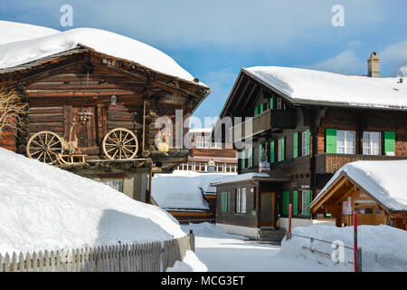 Main street with historical wooden houses in village of Murren in Switzerland - Stock Photo