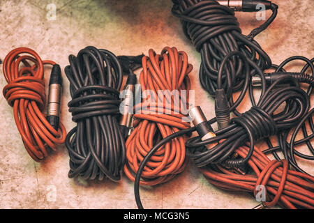 Audio cables for musical instruments and microphones - Stock Photo