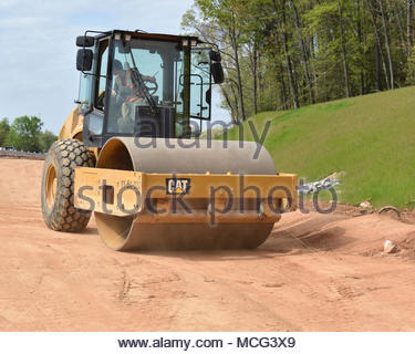 Rolling machine works on highway construction site - Stock Photo