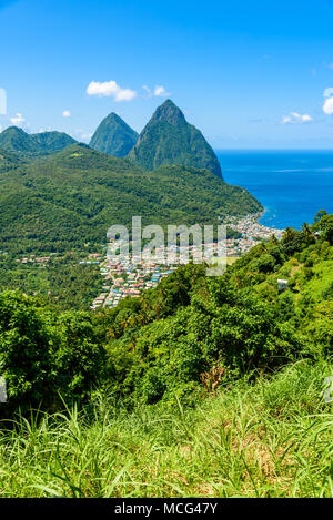Gros and Petit Pitons near village Soufriere on Caribbean island St Lucia - tropical and paradise landscape scenery on Saint Lucia - Stock Photo