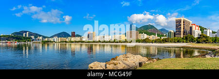 Panoramic morning view of the beach and Botafogo cove with its buildings, boats and mountains in Rio de Janeiro - Stock Photo