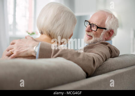Happy nice man smiling to his wife - Stock Photo