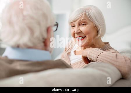 Portrait of happy elderly woman - Stock Photo