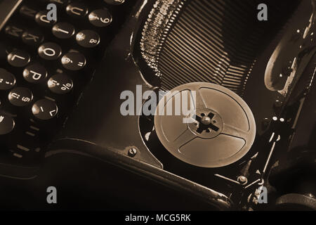 Detail of a part old retro typewriter ready for writing in sephia color - Stock Photo