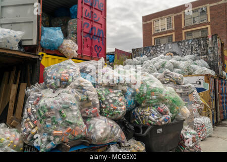 Thousands of bottles and cans await pick-up from distributors at the Sure We Can non-profit redemption center in the Bushwick neighborhood of Brooklyn in New York on Saturday, April 7, 2018. The bags of cans are stored until there are enough to fill a tractor trailer from each individual distributor who is responsible for picking them up. (©ÊRichard B. Levine) - Stock Photo