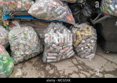 Thousands of bottles and cans await pick-up from distributors at the Sure We Can non-profit redemption center in the Bushwick neighborhood of Brooklyn in New York on Saturday, April 7, 2018. Canners from all over Brooklyn use this center to sort their finds and redeem the deposit money.  The bags of cans are stored until there are enough to fill a tractor trailer from each individual distributor who is responsible for picking them up. (©ÊRichard B. Levine) - Stock Photo