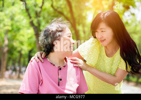 happy senior mother with daughter in the park - Stock Photo