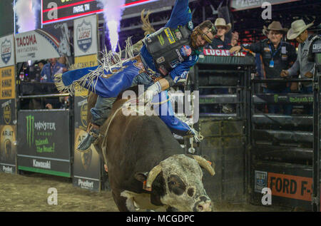 Tacoma, Washington, USA. 15th Apr, 2018. Bull rider CODY NANCE hangs on right out of the gate during the PBR Tacoma Invitational in the Tacoma Dome in Tacoma, Washington. Credit: Jeff Halstead/ZUMA Wire/Alamy Live News - Stock Photo