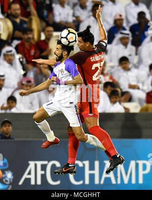 Doha, Qatar. 16th Apr, 2018. Bandar Al Ahbabi (L) of Al Ain FC vies for the ball with Sebastian Soria of Al Rayyan during the AFC Champions League Group D soccer match between Qatar's Al Rayyan SC and UAE's Al Ain FC at Jassim Bin Hamad Stadium in Doha, Qatar, April 16, 2018. Al Ain FC won 4-1. Credit: Nikku/Xinhua/Alamy Live News - Stock Photo