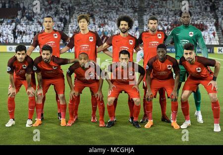 Doha, Qatar. 16th Apr, 2018. Al Rayyan SC players pose for a team photo prior to the AFC Champions League Group D soccer match between Qatar's Al Rayyan SC and UAE's Al Ain FC at Jassim Bin Hamad Stadium in Doha, Qatar, April 16, 2018. Al Ain FC won 4-1. Credit: Nikku/Xinhua/Alamy Live News - Stock Photo