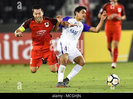 Doha, Qatar. 16th Apr, 2018. Rayan Yslam Al Jaberi of Al Ain FC vies for the ball with Rodrigo Tabata (L) of Al Rayyan during the AFC Champions League Group D soccer match between Qatar's Al Rayyan SC and UAE's Al Ain FC at Jassim Bin Hamad Stadium in Doha, Qatar, April 16, 2018. Al Ain FC won 4-1. Credit: Nikku/Xinhua/Alamy Live News - Stock Photo