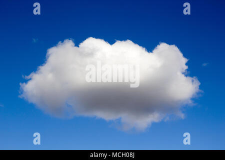 Single fluffy cloud against blue sky - Stock Photo