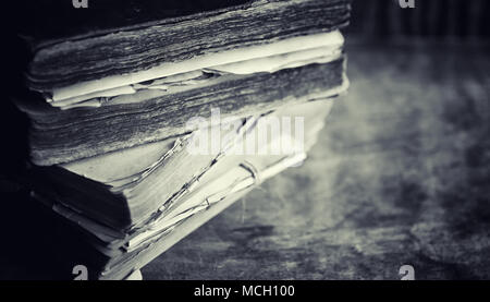 An old retro book on the table. An encyclopedia of the past on a - Stock Photo