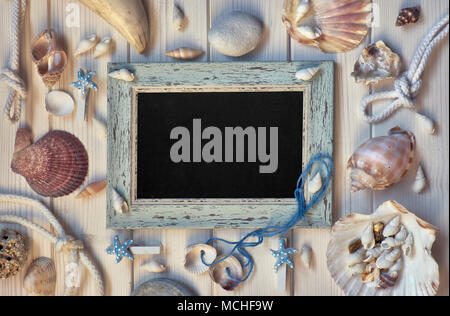 Blackboard With Maritime Decorations on light wood, toned image, text space - Stock Photo