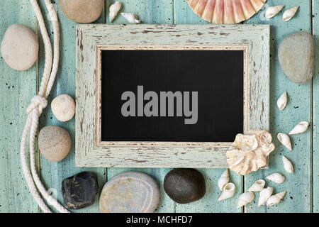Blackboard With Maritime Decorations on light turquoise wood, text space - Stock Photo
