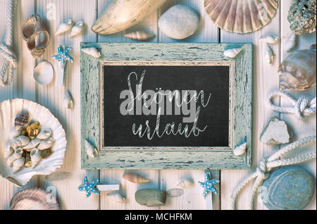 Blackboard With Maritime Decorations on light wood, text in German, 'Shonen urlaub' Means 'Happy holidays' - Stock Photo