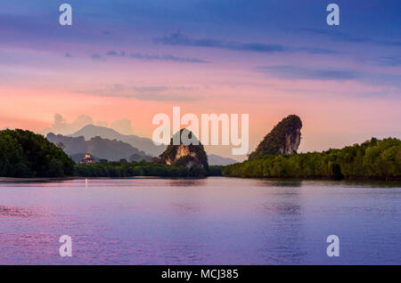Khao kha nab nam at Krabi Thailand. The famous tourist attraction in southern of thailand. Twin mountains have rivers through the middle of the evenin - Stock Photo