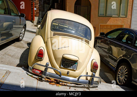 Old VW Beetle, San Francisco, California, USA, North America, parked at an angle on a steep road - Stock Photo
