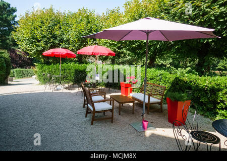 Arranged chairs and tables under the parasols in a restaurant, Brittany, France, Europe - Stock Photo