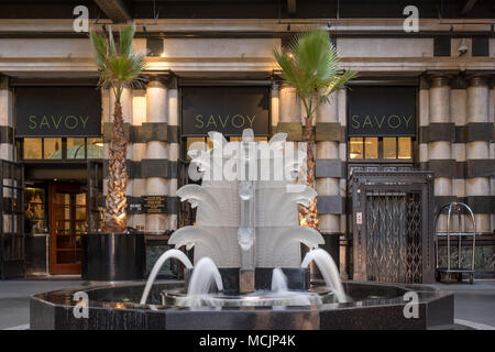 Close up of glass fountain with fish, located outside The Savoy Hotel, off The Strand, London, UK. Fountain designed by French glassmaker Lalique. - Stock Photo