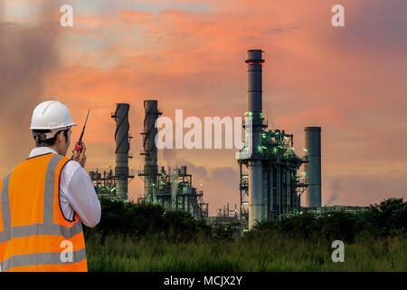 Engineers working in power stations - Stock Photo