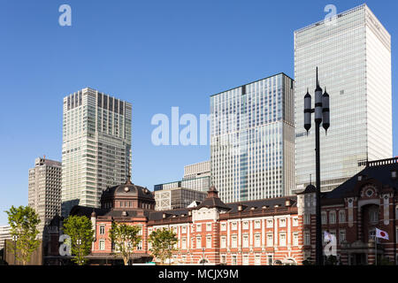 The classic architecture of the Tokyo JR train station contrasts with modern office building in the buisiness district of Marunouchi in Tokyo, Japan c - Stock Photo