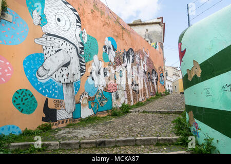 The murals on the walls on the climb to the castle in Lisbon, Portugal - Stock Photo