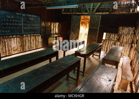 Rural schoolhouse classroom on a coffee plantation in the central highlands of Vietnam. - Stock Photo