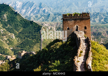 Closeup of tower entrance on Great Wall of China with mountainous  countryside in background - Stock Photo