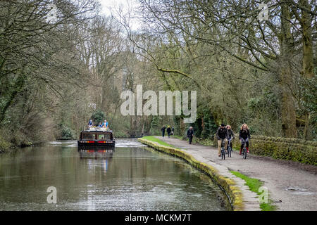 An Hotel boat approaching The Five Rise Locks on the Leeds and Liverpool Canal,  Bingley, near Bradford, West Yorkshire, England. - Stock Photo