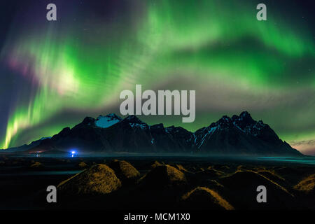 Northern Light, Aurora borealis at Vestrahorn mountains in Stokksnes, Iceland. - Stock Photo