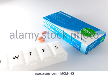 Southend, England - 17 April 2018: A box of Simvastatin 40mg tablets produced by Crecent Pharma Limited. Statins help reduce (LDL) cholesterol. - Stock Photo