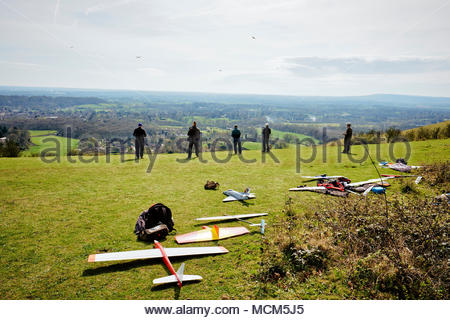 Flying model airplanes on Reigate Hill on the North Downs in Surrey England. - Stock Photo