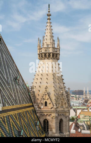 Ornate decorative coloured roof tiles on St Stephens Cathedral. Photographed from the North bell tower viewing platform .Vienna, Austria, Europe. - Stock Photo