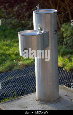 A public drinking fountain in a public park in Somerset England UK
