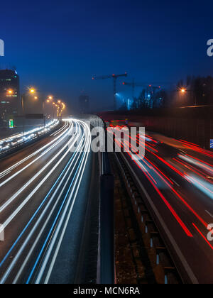 Colorful light trails of busy highway traffic on night, A4 Highway, Katowice, Silesia, Slaskie, Poland. - Stock Photo