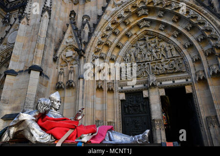 The silver statue of the St. Vojtech (Adalbert), Radim Gaudentius and Radla, by Czech sculptress Karla Vobisova Zakova, was installed in the St. Vitus Cathedral in Prague, Czech Republic, on April 17, 2018. The install of the statue is a part of the repatriation of Czech Cardinal Josef Beran's remains. Beran (1888-1969) became Prague's archbishop in 1946 after he returned from the Dachau Nazi concentration camp, where he was imprisoned following the assassination of Deputy Reich Protector Reinhard Heydrich in Prague. On the photo is seen the statue in front of the cathedral. (CTK Photo/Michal - Stock Photo