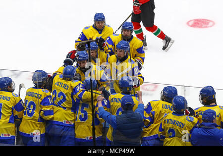Kiev, Ukraine. 17th April, 2018. Players of Ukraine National Team reacts after scored a goal during the IIHF 2018 Ice Hockey U18 World Championship Div 1 Group B game against Hungary at Palace of Sports in Kyiv, Ukraine. Ukraine won 4-3. Credit: Oleksandr Prykhodko/Alamy Live News - Stock Photo