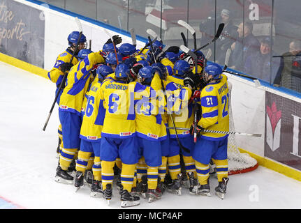 Kiev, Ukraine. 17th April, 2018. Players of Ukraine National Team celebrate the victory after the IIHF 2018 Ice Hockey U18 World Championship Div 1 Group B game against Hungary at Palace of Sports in Kyiv, Ukraine. Ukraine won 4-3. Credit: Oleksandr Prykhodko/Alamy Live News - Stock Photo