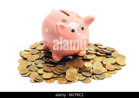 Lucky piggy coin bank on coin heap isolated on white background - Stock Photo