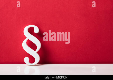 Close-up Of A Paragraph Symbol Leaning On Red Wall