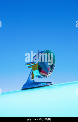 Chromed rear view mirror of a classic car - Stock Photo